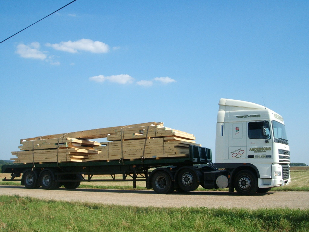 Andersons Flat Bed Trailer transporting wood